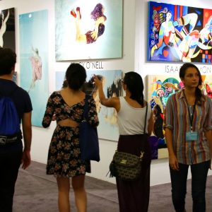 Attendees enjoy the myriad styles of art presented at the show.